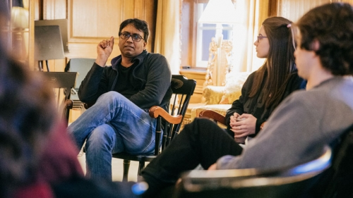 Novelist and Montgomery Fellow Zia Haider Rahman talks with English and creative writing students