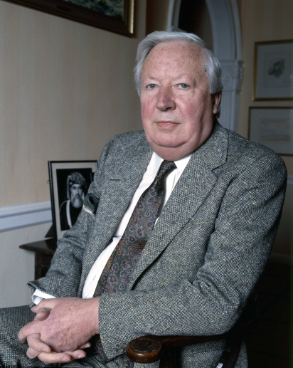 Edward Heath sitting in a chair